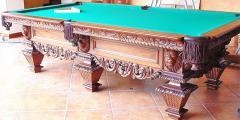Mesa tallada de leones